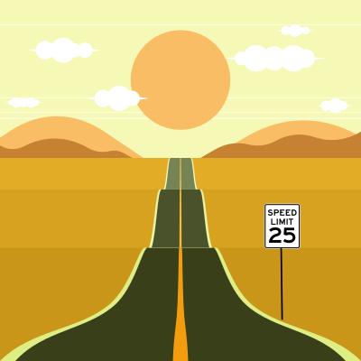 Paisaje árido en el atardecer mostrando el límite de velocidad de 25 km/h